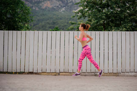 Young woman running to the new life in the morning ready to achieve a new goal.Conception of the healthy lifestyle. 版權商用圖片