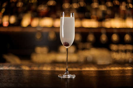 Elegant glass of fresh French 75 cocktail with cherry