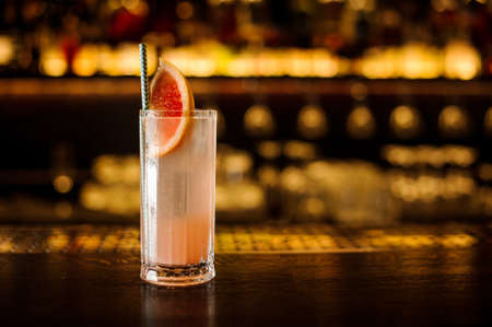 Elegant glass of bright fresh sweet and sour fruit alcoholic cocktail