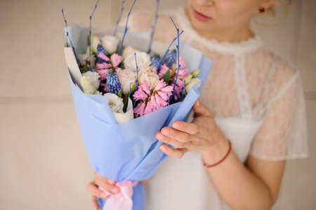 Close shot of girl holding beautiful bouquet with hyacinths