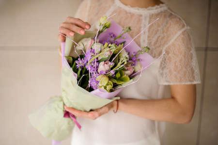 Close shot of wedding bouquet in woman hands
