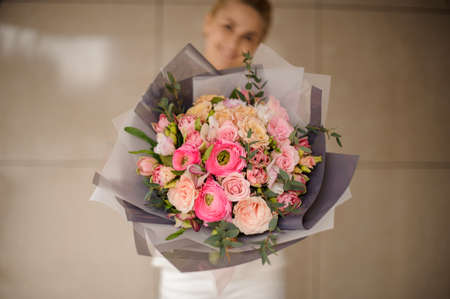 Very beautiful bouquet of roses in gray wrapping Reklamní fotografie
