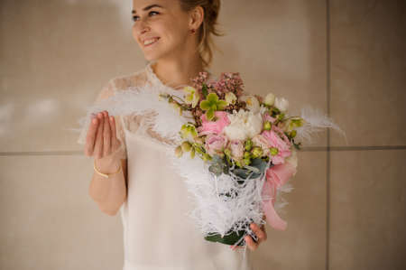 Portrait of a girl with bouquet with decorative feathers Reklamní fotografie - 122777673