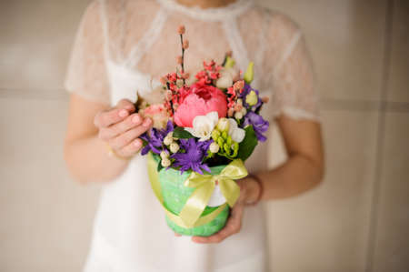 Close up of girl holding a small bouquet in a box Reklamní fotografie