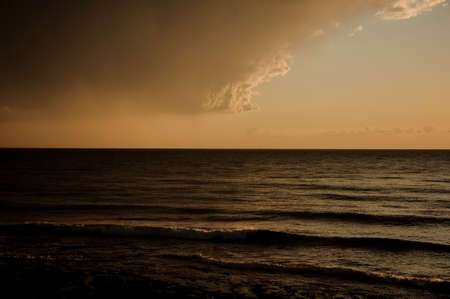 View on dark overcast sky and Mediterranean sea 스톡 콘텐츠