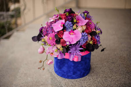 Spring deep blue box of tender pink, violet and blue flowers 스톡 콘텐츠
