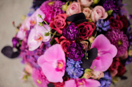 Close up box of tender pink, violet and blue flowers 免版税图像