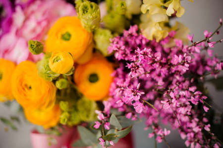 Close up spring box of tender yellow, green and pink flowers 스톡 콘텐츠