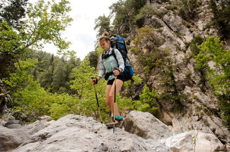Female hiker travelling through rocks in canyon Reklamní fotografie