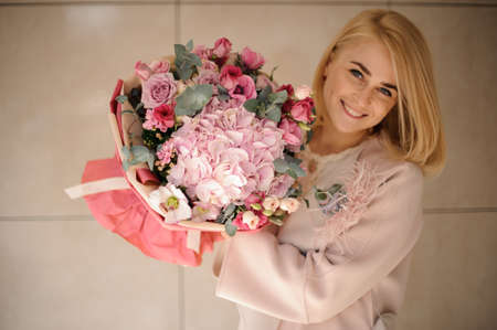 Young woman with beautiful bouquet of flowers
