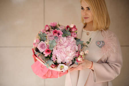 Young woman with amazing bouquet of flowers Reklamní fotografie