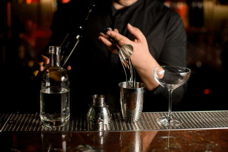 Close-up of pouring cocktail with a shaker Reklamní fotografie