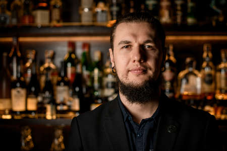 Portrait of adult male bartender in bar