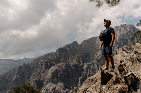 Man stands on top of the mountain