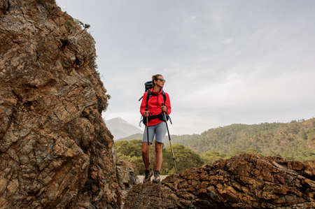 Female trekker poses on hills in Turkey