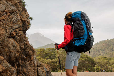 Female traveller looks back on hills in Turkey