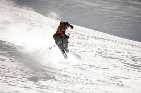 Skier man making jump trick on the ski slope