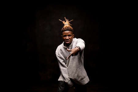 Afro american guy with dreadlocks dancing aggressively Stock Photo