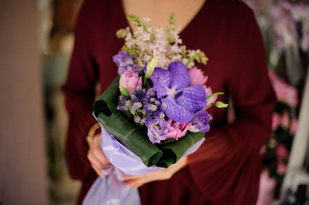 Close-up of woman with a bouquet with iris Standard-Bild - 138033723