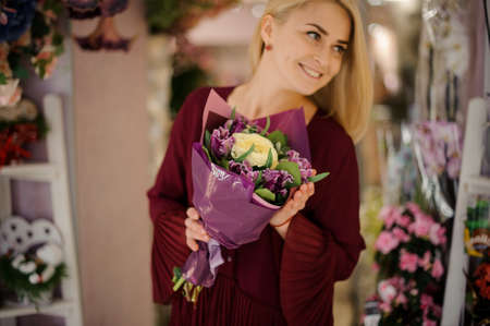 Girl with flower bouquet in purple paper