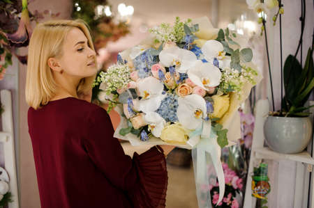 Young woman looking at beautiful flower bouquet Stock fotó