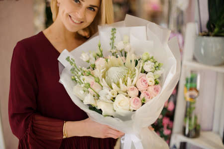 Girl with lush and tender flower bouquet Archivio Fotografico - 138555356