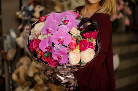 Close shot of lush flower bouquet with pink irises and other flowers
