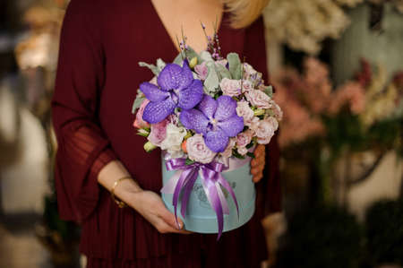 Close-up of irises and roses in box