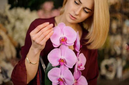 Very cute girl enjoys her irises in pot