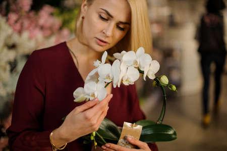 Portrait of blond girl with decorative flowers Stock fotó
