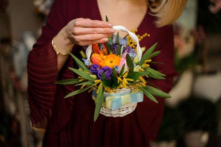 Close shot of small bouquet in wicker basket