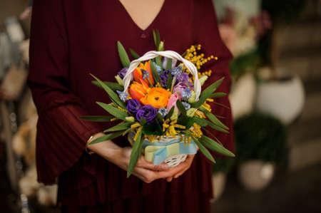 Close-up of fresh bouquet in wicker basket