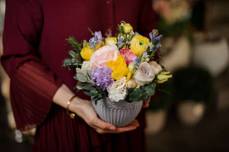 Close shot of small bouquet in textured pot Stock fotó