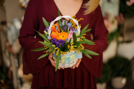 Close-up of small and cute bouquet in decorated wicker basket