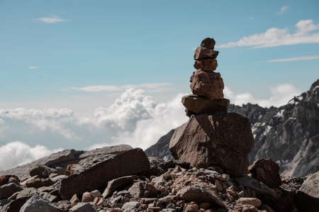 Tower made of stones on top of rocky mountain
