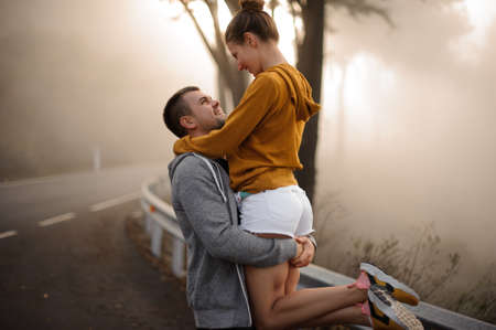 Cute couple hugging each other in forest