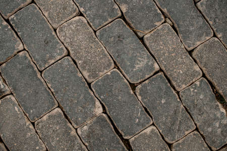 top view of popular street paving slabs. Paving texture of the stones and boulders