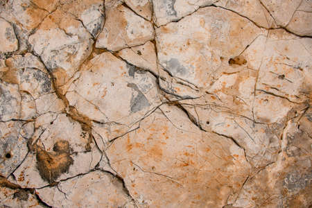 Close-up view of old stone surface with amazing erosion textures and patterns on it