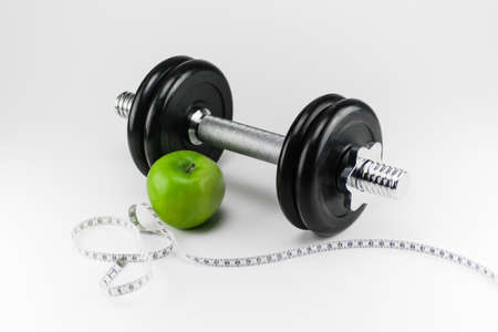 And Barbell with green apple