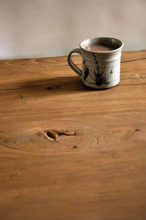A mug on a hardwood table