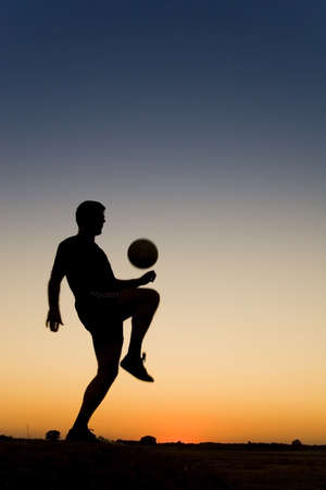 football at sunset photo