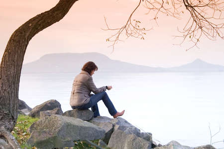 A young woman / lady is sitting and have a relax under a tree Stock Photo - 2105657