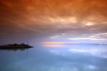 whit: Sunset lake. This phote make in Hungary. Sunset whit Balaton