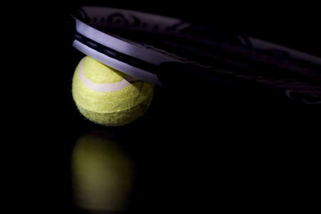 Tennis ball with racket photo