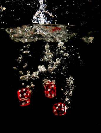 Dice falling into water. photo