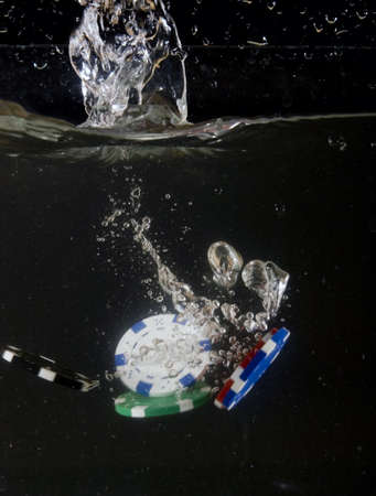 poker chip falling into water photo