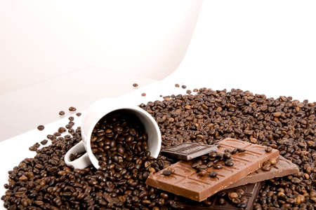 musetti: caffee beans in cup with chocolate