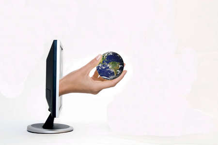 online internet presence: laptop and earth in hand