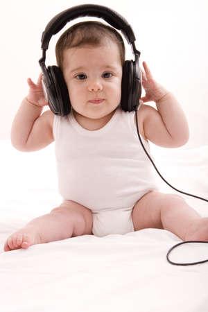 little girl listening to music photo