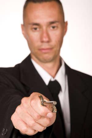 trade secret: businessman holding the key to success